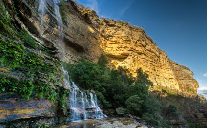 Waterfall By The Golden Cliff