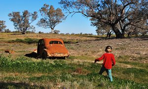 looking into a rusting classic automobile, dumped in a field outside Brewarrina